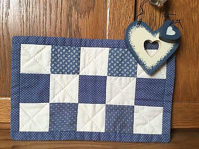 Country Blue placemat with wooden heart accent